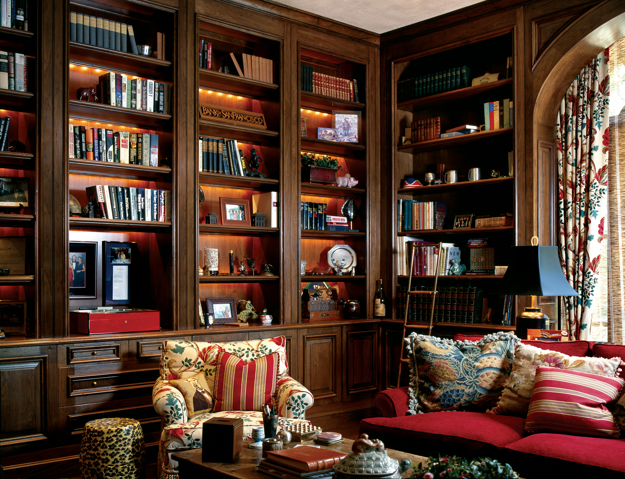 "Library of Distinction This classic library is wrapped in the warmth of walnut, from the bookshelves to the window-arched canopy, the ""aged"" look of the room recreated by Midland using a deep walnut stain and a rich French wax finish. Design by Patricia Stevens"